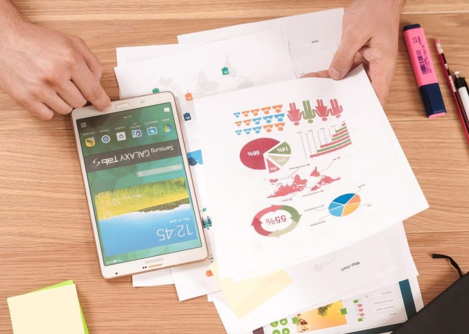 Charts and smart phone on desk