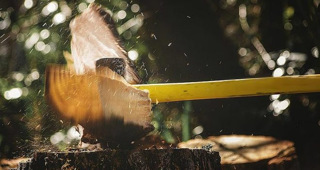 An axe chopping wood