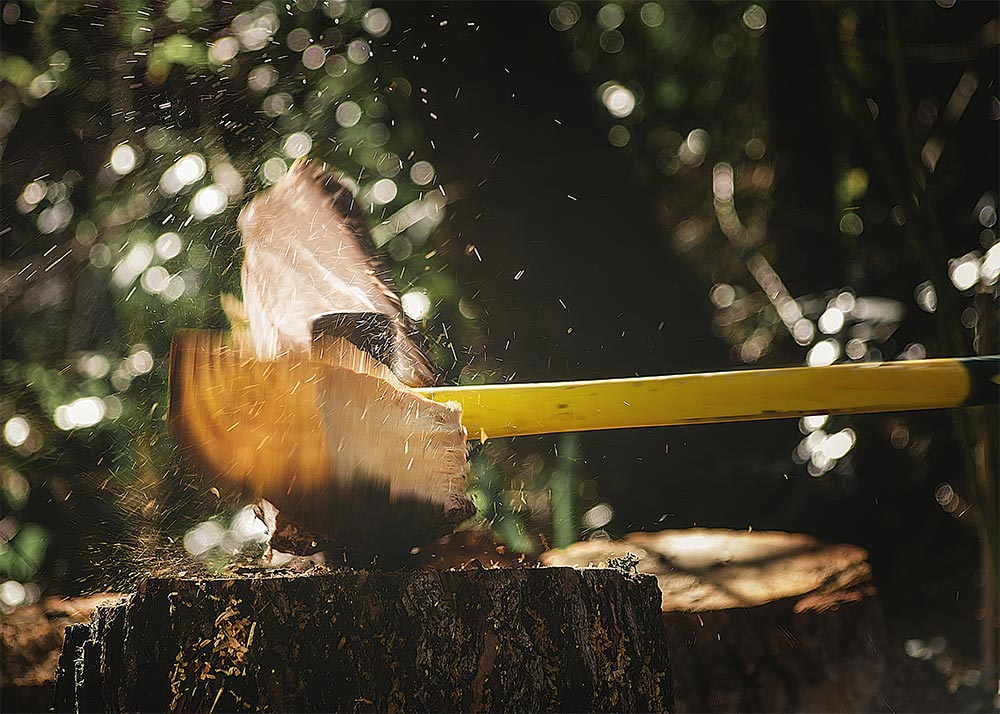 An axe chopping wood