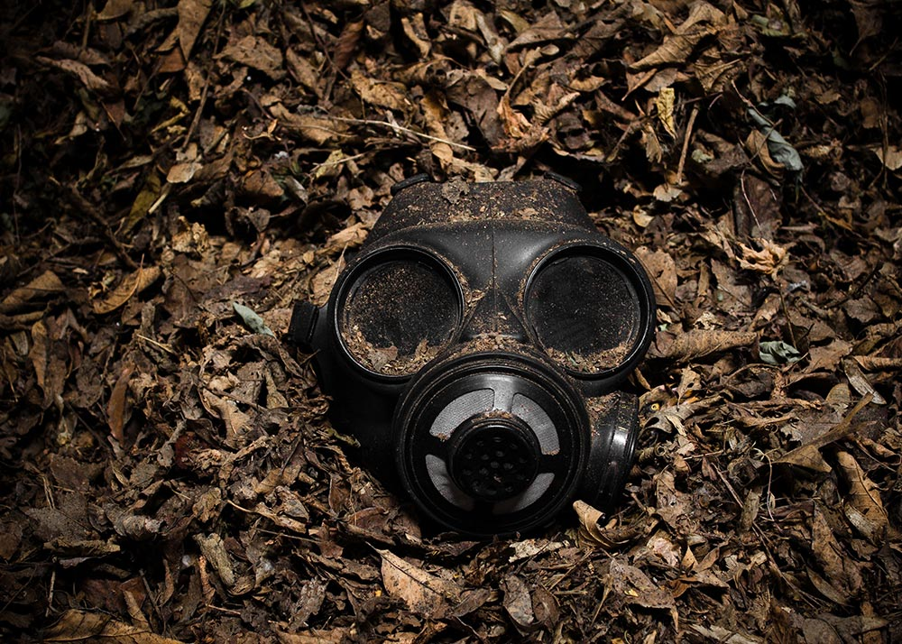 Gas mask on pile of leaves