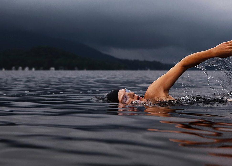 Woman swimming in a lake