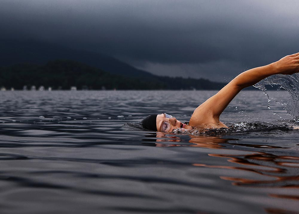 Woman swimming in a lake