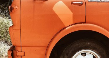 Side of a GMC 4000 orange truck
