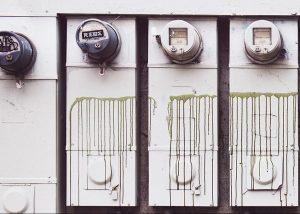 Old energy meters on side of building
