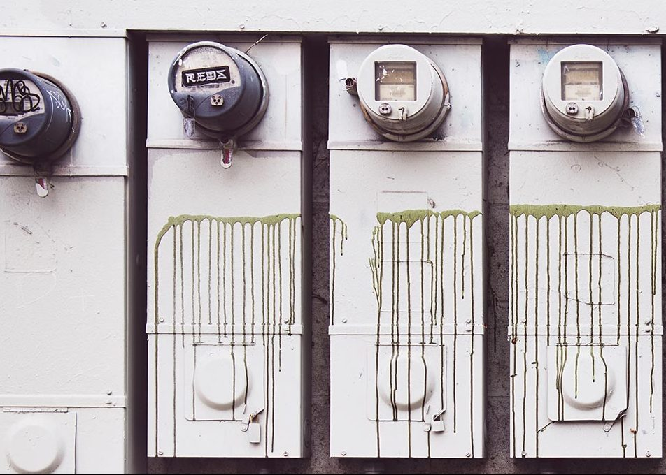 Old energy meters on side of building