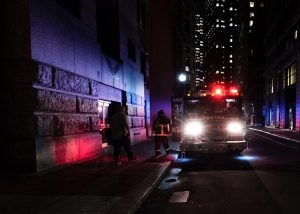 Dark alleyway with police and fire service