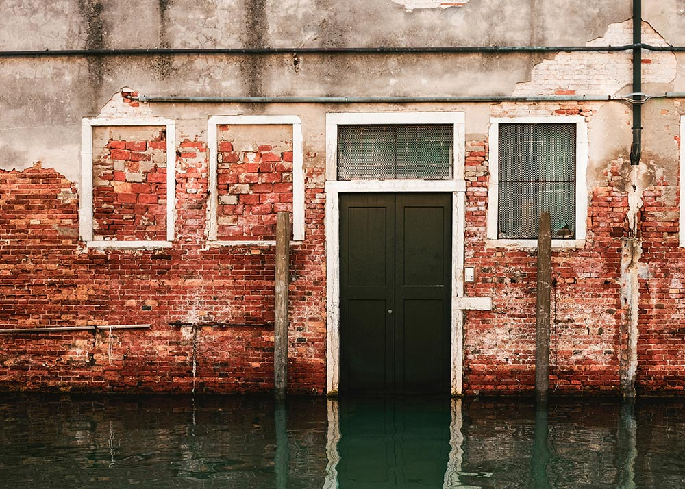 Side of a worn building after flood