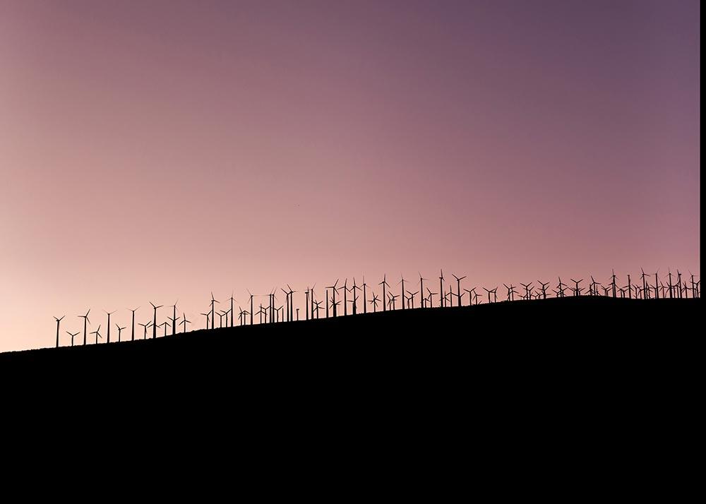 Windmills on the horizon at sunset