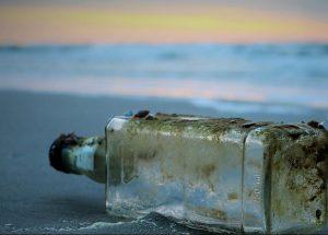 Moldy washed up glass bottle